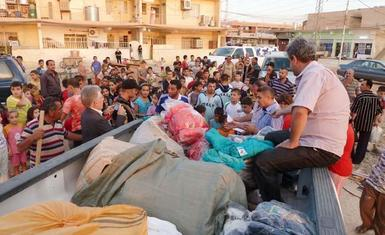 HHRO Delivering winter clothes and heaters in the Nineveh plain and Baghdad