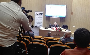 Mrs. Warda attending a seminar titled (the Central Bank and the Economic Reform Policy)