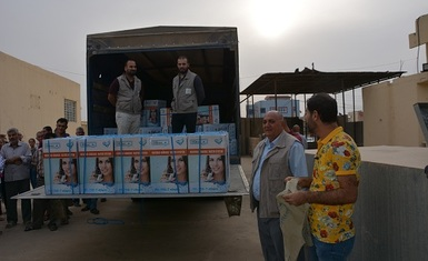 A joint team of Hammurabi Human Rights Organization and Christian Solidarity International CSI distributes household water filtration and desalination systems to 103 family returning to Bartella