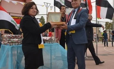 The Presidency of Al-Hamdaniya University awards Mrs. Pascale Warda the shield of the university entitled