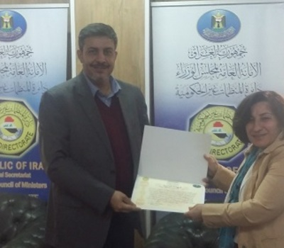 Mrs. Pascale Warda receive an appreciation certificate from the General Secretariat of the Council of Ministers