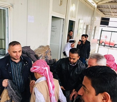 Hammurabi Human Rights Organization continues its relief support to Yazidis in the camp Kertu 3 in Duhok by distributing rain jackets to (156) male and female children.